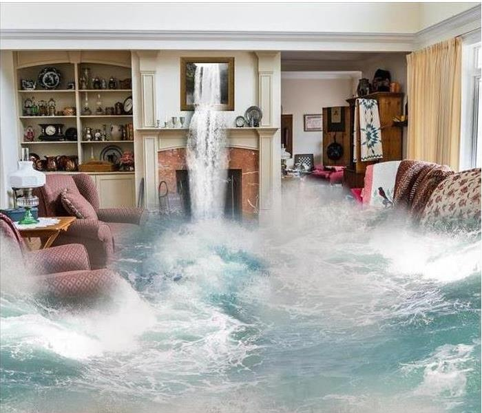 Water flooding into a living room